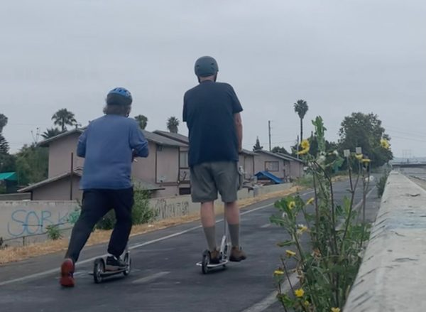 Jorge and I scooting on our Xootr scooters.