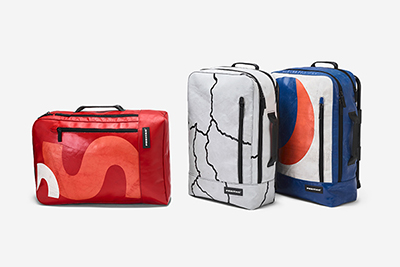 Made of recycled PET fabric with rapid access to the laptop compartment.