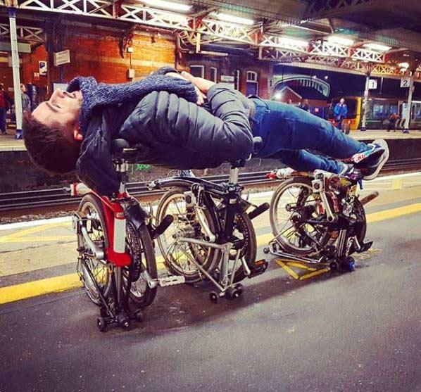 You can tour on a Brompton folding bike.